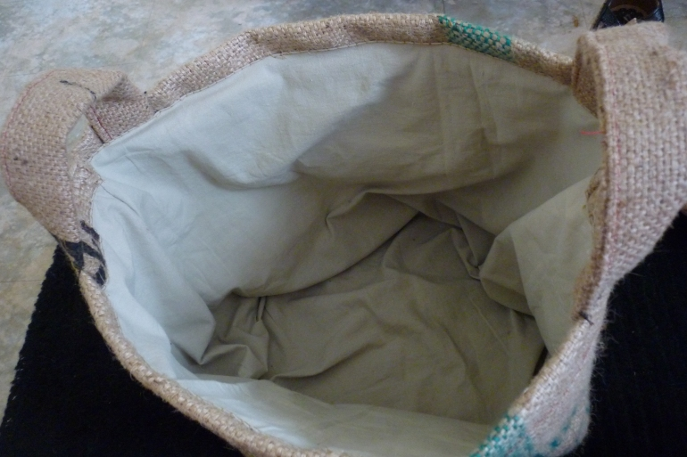 The inner workings of the basket. Cotton in a very light green colour.