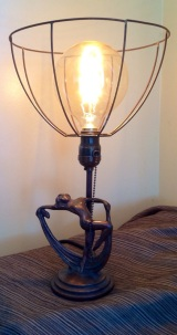 Scarf lady art deco lamp gets an industrial inspired shade.